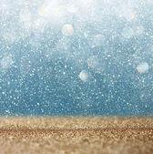 Glitter vintage lights background. light gold and blue. defocused. — Stock Photo