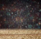 Glitter vintage lights background. light gold and black. defocused — Stock Photo