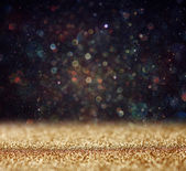 Glitter vintage lights background. light gold and black. defocused — Zdjęcie stockowe