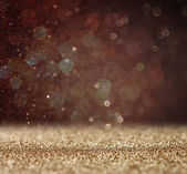 Glitter vintage lights background. light gold and black. defocused — Stock Photo