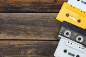 Cassette tapes over wooden table. top view. — Stock Photo