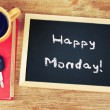 Blackboard with the phrase happy monday written on it, coffee cup and car keys. filtered image. — Stok fotoğraf #50557011