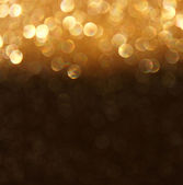 Abstract bokeh lights over blackboard textured background — Stock Photo