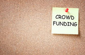 Corkboard with phrase crowd funding — Stock Photo