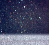 Glitter vintage lights background. light blue and black. defocused — Stock Photo