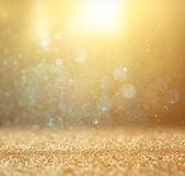 Glitter vintage lights background. light gold and black. defocused. — Foto Stock
