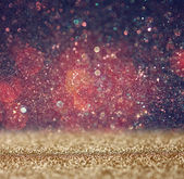 Glitter vintage lights background. light red and black. defocused. — Stock Photo