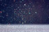 Glitter vintage lights background. light silver and black. defocused. — Stock Photo