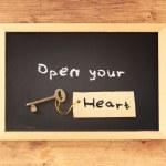 Open your heart written on blackboard — Stock Photo #50560509