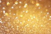 Glitter vintage lights background. light gold and black. defocused. — Stock Photo