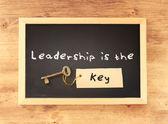 Leadership is the key written on blackboard — Stock Photo