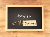 Key to success written on blackboard — Stock Photo