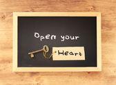 Open your heart written on blackboard — Stock Photo