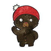 Cartoon waving black teddy bear in winter hat — Stockvektor