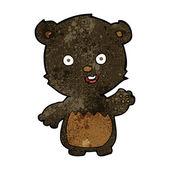 Cartoon waving black bear cub — Stock Vector