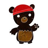 Cartoon black bear wearing hat — Stock Vector