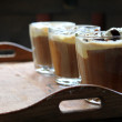 Iced coffee glasses on an old-style tray — Stock Photo