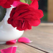Red rose and falling petals — Stock Photo