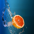 Fresh lemons under water jet splash — Stock Photo