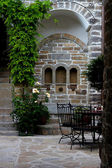 Patio,European style green door of old building — Stock Photo