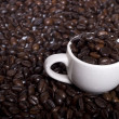 Coffee beans and cap of coffee — Stock Photo