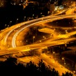 Abstract lights from cars on road junction with bridge — Stock Photo #33128543