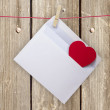 Hearts and blank envelop  on wooden background — Stock Photo