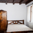 Foto de Stock  : Close up on a bed in a bedroom