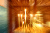 Candles in a church . Radial blur — Foto Stock