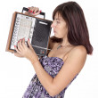 Stock Photo: Young women tuning vintage radio