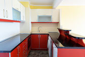 Modern kitchen interior with red  and white furniture  — Stock Photo