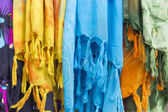 Colorful scarves at a market in Greece. Colors of textiles — Stock Photo