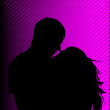 Stock Photo: Black silhouette of a guy and girl kiss