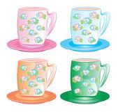Яркая чашки на блюдца с изображением — Стоковое фото
