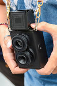 Vintage old camera 2 lens and hands holding — Stock Photo