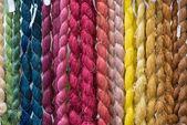 Colorful raw silk thread background — Stock Photo