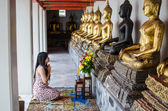 Asian woman meditation pray buddha in thai temple — Stock Photo