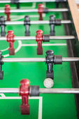 Close up of a foosball game with soccer ball — Stock Photo