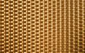 Golden metal weave texture background — Stock Photo
