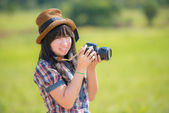 Girl with camera on nature — Stock Photo