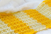 With white fur Texture of a knitted cloth of brightly yellow and orange color, in a strip — Stock Photo