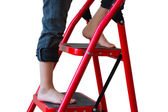 Feet of the girl on a step-ladder — Stock Photo