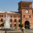 Tower with hours on a central square of Yerevan and the fountain — Stock Photo