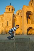 The boy against Grigory Prosvetitelya's cathedral — Photo