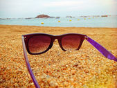 Sunglasses in the sand — Stock Photo