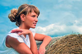 Girl with haystack — Stock Photo