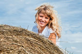 Girl on haystack — Stock Photo