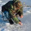 Stock Photo: Mon winter fishing