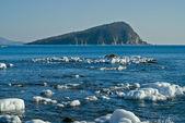 Small island in winter sea — Stock Photo