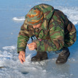 Man on winter fishing — Stock Photo #14179450